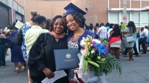Yanick Rice Lamb with former student Lisa Wilmore after the School of Communications' graduation ceremony.